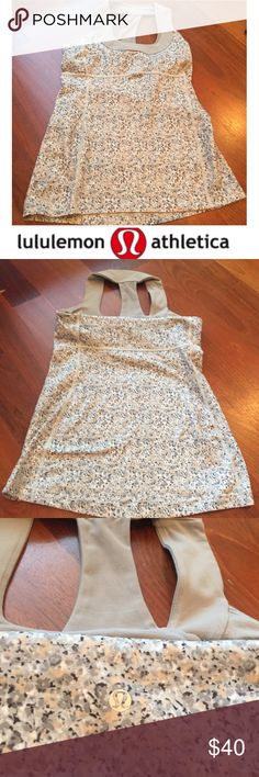 Lululemon Gray & Tan Pattern Yoga Tank Lululemon Gray & Tan Pattern Yoga Tank. Built in bra, but no padding. 26 inches long. 15.5 inch bust. See the Lulu size guide for bust info on a size 8. Gently worn. Excellent condition. Feel free to make an offer. lululemon athletica Tops Tank Tops