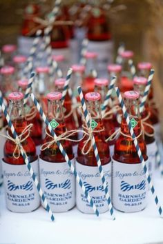 Koozies look festive with a colorful straw tied on.  See more wedding favor koozies and party ideas at one-stop-party-ideas.com