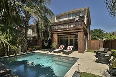 5341 Fairdale Lane. Reverse view over pool showing patio and decks.  Bernstein Realty, Houston Real Estate.