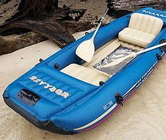 Inflatable boat w/ clear bottom for sea viewing.