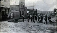 Two Gentlemen about to duke it out in front of the Blue Ribbon Saloon, Dillon, Wyo., 1904