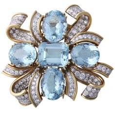 TIFFANY & CO SHLUMBERGER Diamond, Gold, and Aquamarine Brooch | From a unique collection of vintage brooches at https://www.1stdibs.com/jewelry/brooches/brooches/
