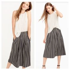 J Crew Stripped Pleated Skirt Navy striped midi skirt. Sits waist. Lined. Elastic waistband on seam pockets. Machine wash. Almost 22 inches length. J. Crew Skirts Midi