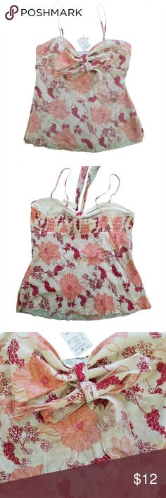 """NWT CHARLETTE RUSSE Floral Spaghetti Strap Top Size: Juniors Large Color/Pattern: Cream with Red & Peach Floral  Style: Spaghetti strap, Tie Front Camisole Materials: 100% Cotton  Measurements (approximate, all laying flat) Underarm to underarm: 17"""" Width at Bottom: 22"""" Length: 16""""  Condition: New With Tags with no holes, tears, or stains.  PLEASE CHECK MEASUREMENTS TO ENSURE PROPER FIT!  I am a smoke-free, Dog-friendly home! B85 Charlette Russe Tops Camisoles"""
