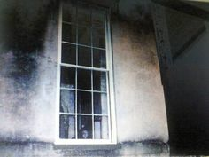 Georgia - This photo from bethdolgner.com shows what appears to be a forlorn looking child staring out the window of Savannah's famously haunted home at 432 Abercorn Street. Legend has it a girl died in the house after her father tied her to a chair and left her to die of heat exhaustion. Could this be her or is it merely a case of extreme pareidolia?