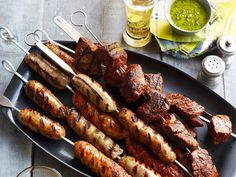 Prepare beef tri-tip and fresh sausage link skewers, then serve with homemade salsa and chimichurri.