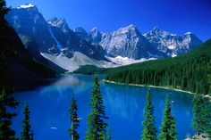 The impossibly blue waters of Moraine Lake, surrounded by the Rocky Mountains in the Banff National Park.