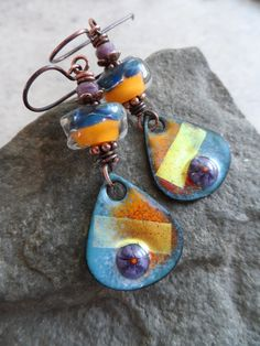 Fun, colorful enameled copper charms, expertly handcrafted by an etsy artisan, team up with organic artisan-made lampwork beads, as well as Czech glass rondelles. Suspended from solid oxidized copper earwires, these awesome earrings measure about 2 1/4 from top of earwires. One-of-a-kind beautiful