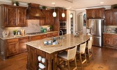 We love the rich color of the cabinets in this kitchen from @Lennar Dallas
