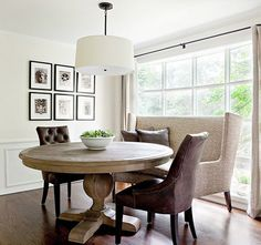 LOVE the banquette kitchen seating and drum pendant