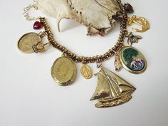 Golden ship charm Statement necklace   by luxandlove, loads of vontage charms on gorgeous sparkly amber coloured vintage chain. Heavy!