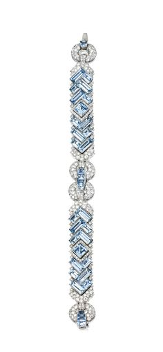 PLATINUM, AQUAMARINE AND DIAMOND BRACELET, CIRCA 1930.  Set with fancy-shaped aquamarines, accented by single-cut diamonds weighing approximately 7.00 carats, length 7 inches.