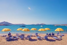 """Get the perfect summer mani inspired by the """"Paros Yellow Umbrellas"""" print from Gray Malin's Greek Isles photography series. Photography Series, Beach Photography, Yellow Umbrella, Greek Isles, Summer Wallpaper, Beach Images, Tourist Spots, Thessaloniki, Paros"""
