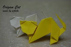 Origami Cat by Toshie Takahama Designer: Toshie Takahama Folder and Photo: Difficulty level: Easy Time to fold 45 min. Folded from a one square Crepe Paper, Navy Blue , about x 20 cm. Diagrams on Classic Origami by Paul Jackson pages Dinosaur Origami, Origami Cat, Origami And Quilling, Kids Origami, Origami Butterfly, Useful Origami, Origami Animals, Paper Crafts Origami, Origami Instructions For Kids
