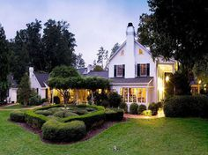 """Fearrington House Inn, Pittsboro, N.C. Located eight miles from Chapel Hill, this """"charming inn"""" was constructed in 1987 on an old dairy farm and takes its cues from the English and French countryside. Winding redbrick pathways lead guests through """"beautiful gardens"""" with native plants."""