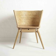 Brodgar Chair by Gareth Neal and Kevin Gauld. A reworking of the traditional Orkney chair in oak and straw.