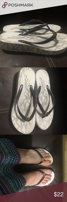 Michael kors flip flops Mk flip flops some fading from wear but not noticeable when wearing . Paid $68 only wore a few times . Make an offer !!! KORS Michael Kors Shoes Sandals