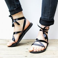 Learn how to make your own ribbon sandals with this easy DIY! All you need are flip-flops, ribbon, and glue gun for this fun fashion craft.