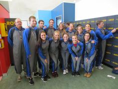 Members of the BUAD/FINC group--in matching jumpsuits--prepare to climb the Sydney Harbour Bridge in Australia.