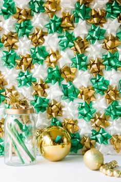 DIY Christmas Gift Bow Backdrop for a photo booth or party decor