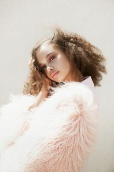 Angelic look in pale pink fur top.