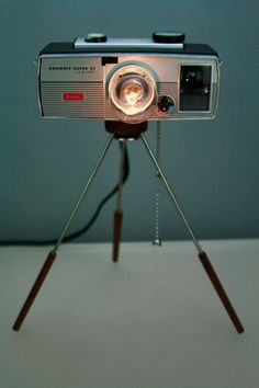 This is a one of a kind Camera lamp made from a vintage Kodak Super 27 camera.