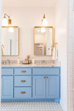 Modern farmhouse bathroom with bright hydrangea blue vanity and marble countertops. Brass hardware, brass lighting, and brass mirrors complete the beach vibe of this home on Lake Eufaula. #bathrooms #makeover #color #paintcolors #brass #farmhouse #fixerupper #southernlivingwww.pencilshavingsstudio.com