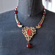 Ruby Red Vauxhall Glass and Gold Heart Art Nouveau Necklace Bohemian Gablonz Floral Filigree Czech Gypsy    This necklace dates from the Art