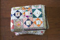 Folded economy block quilt; love the colors. (From A Quilt is Nice.)