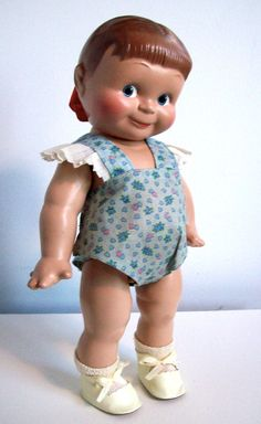 "This is Giggles, 13"" tall, all composition, made by Cameo. She is a sister to Kewpie. She was made in 1946."