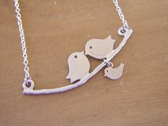 Love Birds and Baby Necklace - Rhodium Plated on Sterling Silver Chain. $21.50, via Etsy.