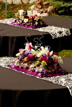 Purple white black wedding table centerpiece.