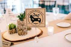 With a love for dogs, the bride and groom featured customized wedding table numbers like this corgi design. | Jamie & Josh's Sweet Spencer, MA Real Wedding by Zac Wolf Photography #myweddingmag