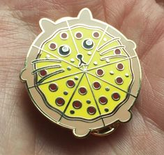 A fat pizzacat pin, BECAUSE WHY NOT.