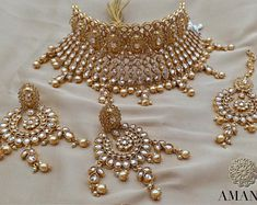 We have a huge collection of Indian Bridal Jewellery set at the best price to add moonlight to your special occasion. Here you can find the stylish and latest Indian wedding jewellery with great deals & discounts. Indian Bridal Party, Indian Bridal Jewelry Sets, Indian Jewellery Online, Bridal Bangles, Indian Bridal Wear, Wedding Jewelry Sets, Bridal Necklace, Bridal Jewellery, Gold Jewellery