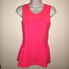 Peplum Fitness Top Super adorable hot pink fitness top, with a peplum waist and floral design in fabric around check/neck/upper back. Worn once! Makes me think of lulu lemon for some reason. American Eagle Outfitters Tops Tank Tops