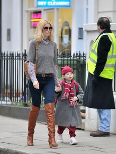 Inspiration for all fashionista moms  - celebrity mom style - Claudia Schiffer - dress shirt over a long sleeved button down, over the knee boots with matching bag