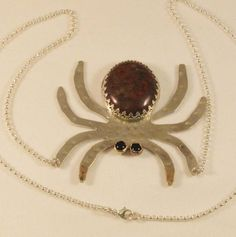 Handcrafted sterling and 14K gold spider necklace with natural Blood Poppy Jasper stone and Black Onyx eyes.