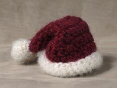 crochet santa hat. With some modification could use for jam toppers.