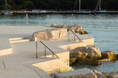 Completed in 2014 in Rovinj, Croatia. Images by Joao Morgado. Mulini Beach is located in an attractive area of Rovinj, on the exit from the central part of the city and in the continuation of the promenade, in. Landscape Arquitecture, Landscape And Urbanism, Landscape Walls, Garden Landscape Design, Beach Landscape, Urban Landscape, Landscape Architects, Parque Linear, Landscaping Las Vegas