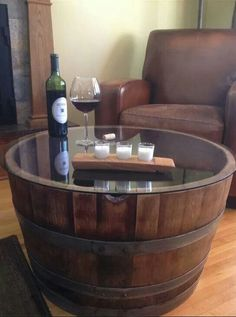 Here's a grate way of using a wine barrel as a coffee table.  use the bottom side up so you can see the winery name & label. I also have them above my stove top in the kitchen. We love wine & love decorating with wine barrels! ❤️❤️