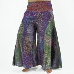 Peacock Flare Pants, Step out in exotic style that is sure to impress with the bold patchwork perfection of our peacock flare pants. These 100% rayon pants feature an elastic waistband in the back and a wide leg bell bottom fit, with unique patterns and colors that bring a blast of creative cheerfulness to any outfit! $32