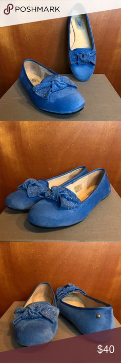 UGG Studded Bow Blue Suede Shoes! Gorgeous shearling insole UGG Australia studded bow tie flat. These shoes have a stunning blue (with a hint of periwinkle) suede upper that is flawless, the suede bow is brass/gold studded.  Practically brand new, no box, no tags, but pristine condition. Make me an offer, these are so cute! UGG Shoes Flats & Loafers