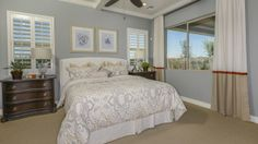 The white shutters on these bedroom windows at Elliot Groves by Taylor Morrison, give this room a sophisticated and rustic feel. #new #home #Gilbert #bedroom #rustic #decor #rusticbedroom #whiteshutters