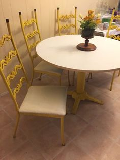 Found on EstateSales.NET: VINTAGE Wrought Iron 4 chairs and round table base