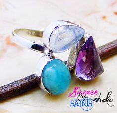 This is a GENUINE Moonstone, Larimar & Amethyst ring set in 100% pure .925 Sterling Silver!     Size 8     This ring is made in USA, not imported. Artisan crafted and FABULOUS!     The 3 stones are all genuine gemstones. Moonstone, rough cut amethyst and larimar.