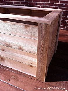 Add trim to the corners and top of a planter box.
