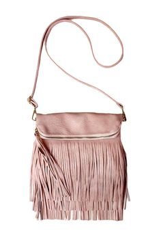 "Adorable fold-over zippered vegan leather fringe cross-body purse in rose-quartz pink. Fold-over fastens with magnetic clasps and has a zippered pocket inside. This is a great purse to wear on a night out or with any bohemian inspired outfit!  Measures 10"" x 12"" or 15"" when unfolded with a 50"" long adjustable strap.  Fringe Vegan Leather Crossbody by Carte Blanche. Bags - Cross Body Vancouver Canada"