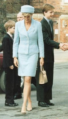 """March 09, 1997: Prince William's Confirmation.. Princess Diana in a blue Chanel suit. """"The suit is a pale blue boucle light wool with fringed lapels and inset pocket detailing worn with an above the knee skirt. For the confirmation, Diana wore a matching pillbox hat with a beige handbag and matching Chanel heels. It was truly French Couture at its best""""!"""