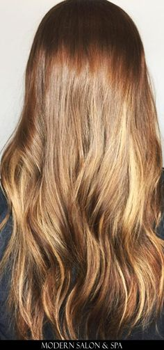 Long brown hair with extensions by Katherine Underwood at Modern Salon & Spa in Charlotte, NC